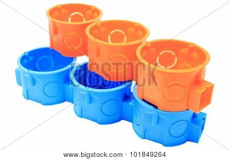 Stack Of Orange And Blue Electrical Boxes. White Background