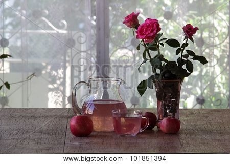 Apple Compote In A Transparent Jug And ????? From Roses