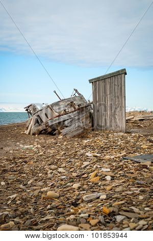 Abandoned Ship On The Shore In Svalbard