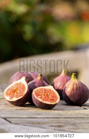 Figs On A Wooden Table Outside.
