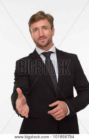 Handsome man giving handshake