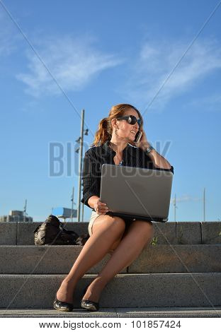 Business Woman Sitting On The Street
