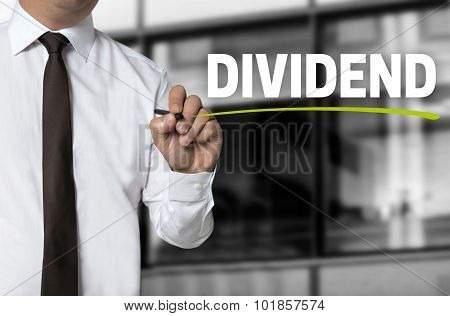 Dividend Is Written By Businessman Background Concept