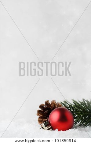 Christmas Background With Red Bauble And Foliage On Snow