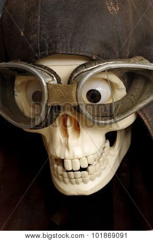 old motorcycle goggles and helmet the skull