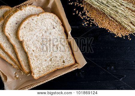Whole Wheat Bread Background / Whole Wheat Bread / Whole Wheat Bread On Black Wooden Background