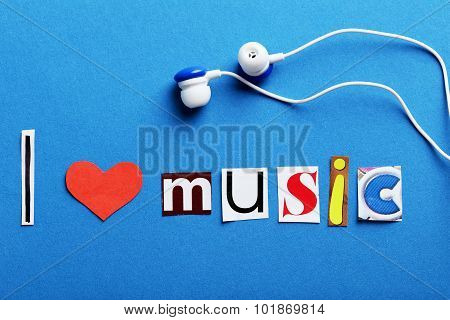 The Word I Love Music In Cut Out Magazine Letters With Earphones