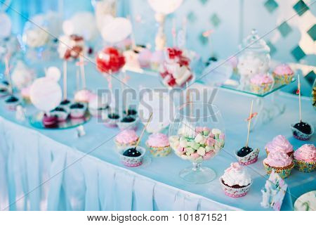 Various Dessert Sweet Cupcakes, Candy, confection On Table. Swee