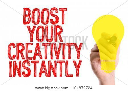 Hand with marker writing: Boost Your Creativity Instantly