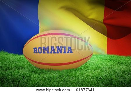 Romania rugby ball against waving flag of romania