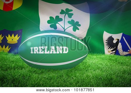 Ireland rugby ball against close-up of irfu flag with the centenary logo