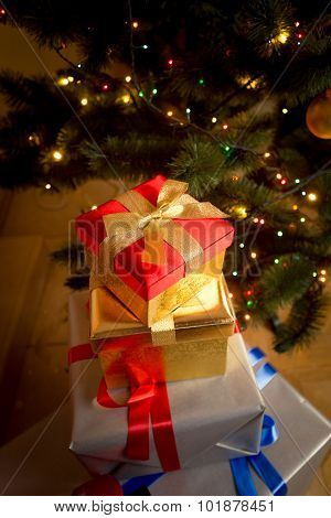 Closeup Of Wrapped Gifts In Boxes Under Christmas Tree