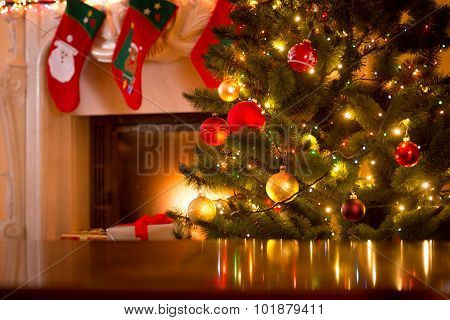 Christmas Background Of Table Against Christmas Tree And Fireplace