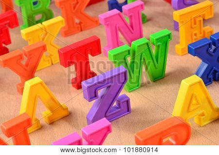 Plastic Colorful Alphabet Letters On A Wooden Background