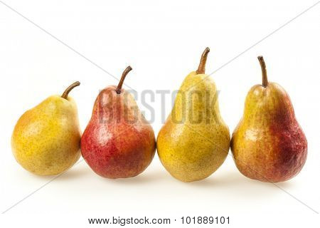Row of four ripe pears, yellow and red, on pure white background