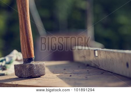 Construction Site Concept With A Wooden Mallet And Level