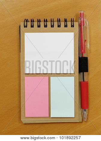 Blank Sticky Notes Stuck To Spiral Notebook
