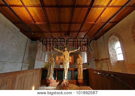 SOUTH TYROL, ITALY - OCTOBER 2013 : The Crucifixion scene, circa 1330, with figures of Mary and John in attendance at Tyrol Castle in the Burggrafenamt, South Tyrol, Italy on 19 october 2013.