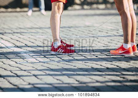legs in bright sneakers