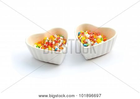 Colorful Heart and Star Cake Sprinkles and Cup isolated in white background