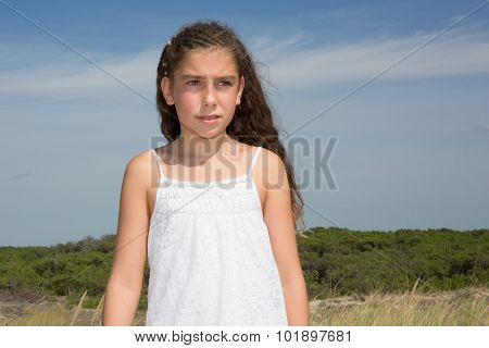 Young Brunette Girl In Summer White Dress Standing On Beach