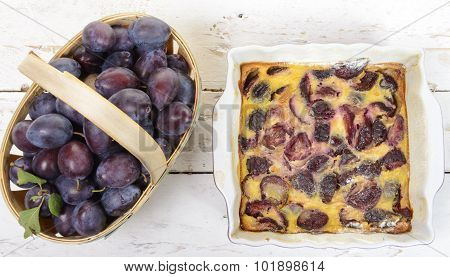 Plum Clafoutis With A Basket Of Plum