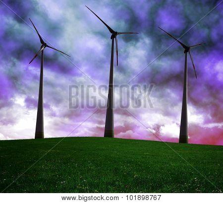 Wind turbines in dark storm clouds.