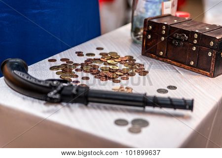 Old pistol, coins and a box