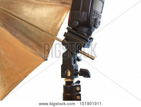 Light stand with flash and umbrella