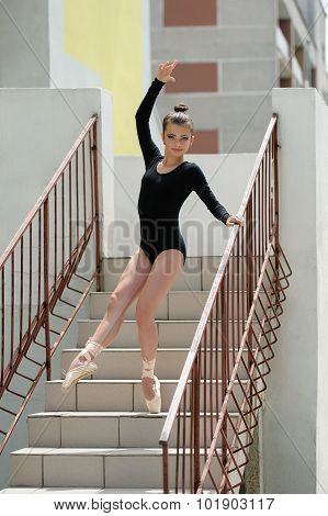 Young Beautiful Ballerina Posing On The Stairs