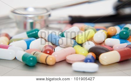 Various pharmaceuticals with stethoscope in the back