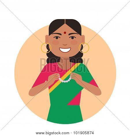 Indian woman holding necklace