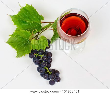The Cluster Of Grapes  Lie Near A Wine Glass With Brandy