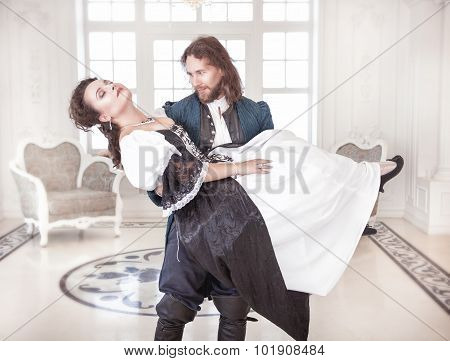 Handsome Man In Medieval Costume Picking Up Beautiful Woman