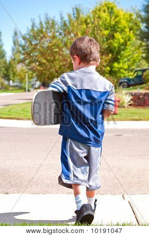 Little Boy Ready To Skateboard