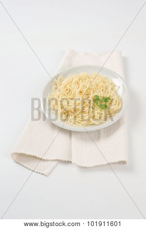 plate of cooked noodles on white place mat