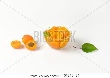 halved apricots in the compote, served in the glass bowl