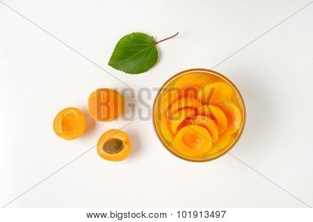 overhead view of glass bowl with compote apricots