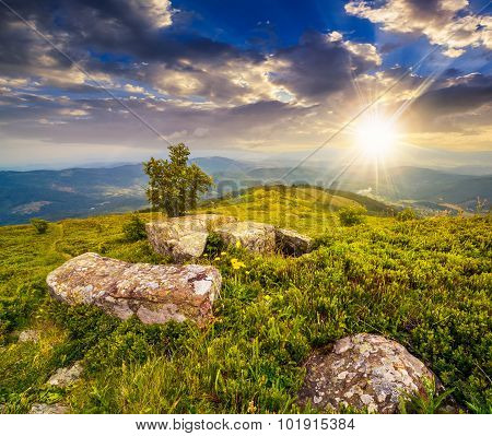 Boulders On Hillside Meadow In Mountain At Sunset