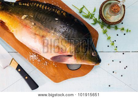 Raw Fish (tench?) With Basil On A Wooden Table, Top View