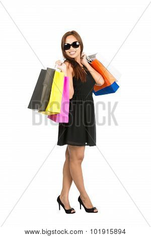 Asian Shopping Bags Over Shoulders Full At Camera