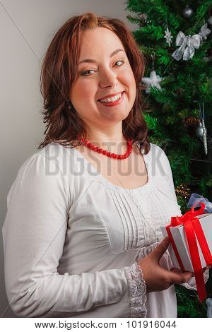 Nice smiling woman with present