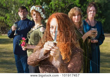 Female Pagan With Athame Outdoors