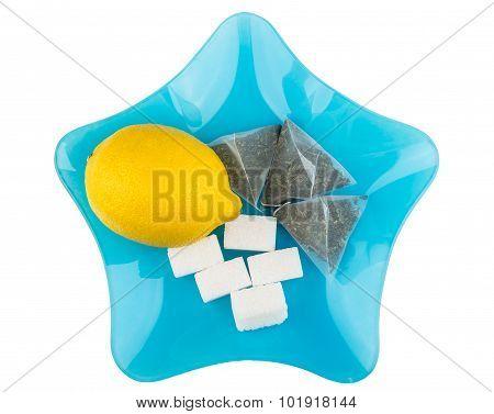 Lemon, Sugar And Tea Bags In Blue Glass Plate