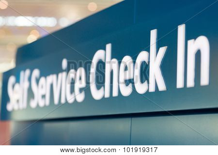 self service check in sign at airport