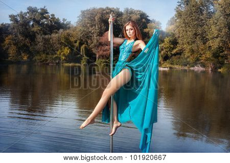 Girl Dress Dancing On A Pole In The Lake.