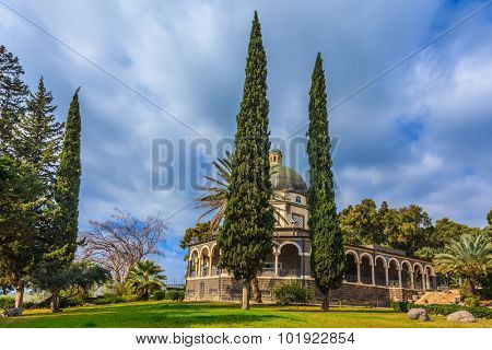 Catholic monastery and a small church Mount of Beatitudes. Beautiful park of cypress. Israel, the shores of Lake Kinneret
