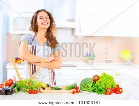 Happy Young Woman Cooking in the kitchen at home Healthy Food, Vegetable Salad. Diet. Dieting Concept. Healthy Lifestyle. Prepare Food. Slimming, weight loss