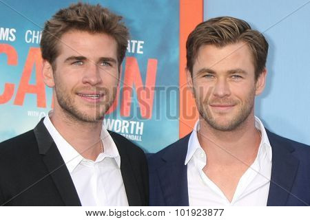 LOS ANGELES - JUL 27:  Liam Hemsworth, Chris Hemsworth at the