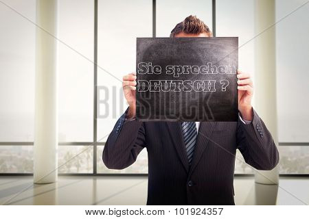 Businessman showing board against window overlooking city